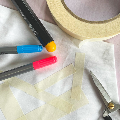 Masking Tape marking out abstract shapes on Cotton Twill, ready to use with fabric pens