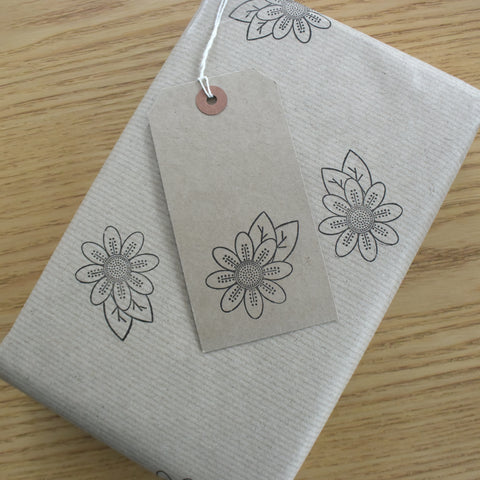 Wrapped gift in hand stamped gift wrapping