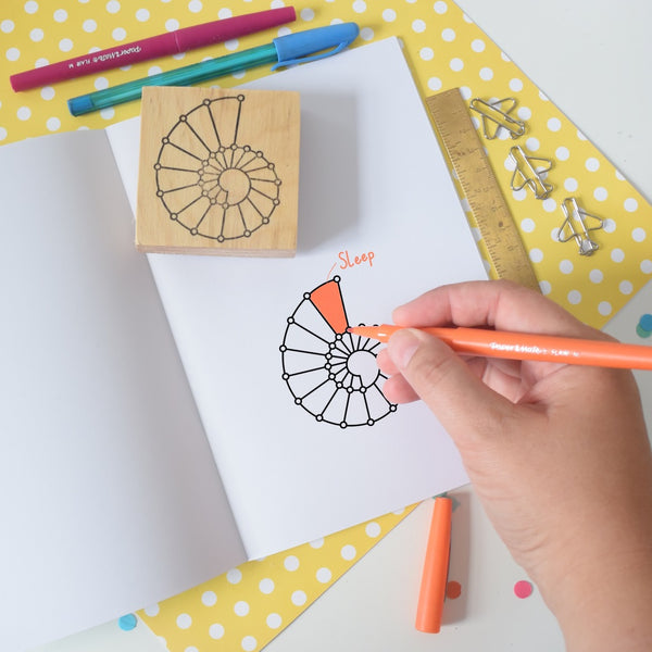 24 segment spirodex stamp with hand holding pen colouring in segments