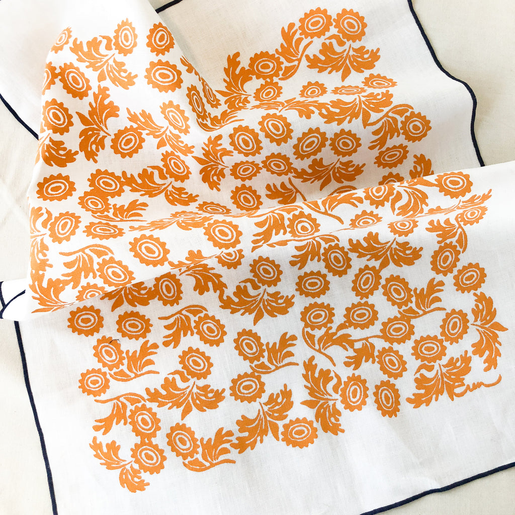 These beautiful linen tea towels are handmade and printed and sewn on 100% linen and features a fun tangerine print and a surged navy poly hem. | Salt Air Supply