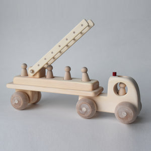 Handmade wooden fire engine toy with five removable peg people | Salt Air Supply