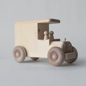 Wooden piggy bank truck featuring two removable peg people | Salt Air Supply