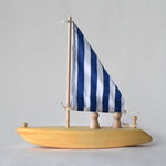 Handmade wooden toy sailboat with blue and white fabric sail | Salt Air Supply