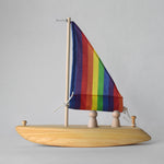 Handmade wooden toy sailboat with rainbow fabric sail | Salt Air Supply