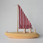 Handmade wooden toy sailboat with red and white fabric sail | Salt Air Supply