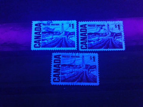 Three varieties of hibrite paper on the $1 Edmonton Oilfield stamp from the 1967-1973 Centennial Issue of Canada