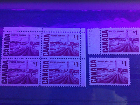 Three varieties of the low fluorescent flecked paper on the $1 Edmonton Oilfield stamp from the 1967-1973 Centennial Issue of Canada