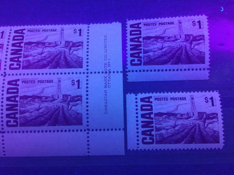 Three varieties of low fluorescent paper on the $1 Edmonton Oilfield Stamp of the 1967-1973 Centennial Issue of Canada