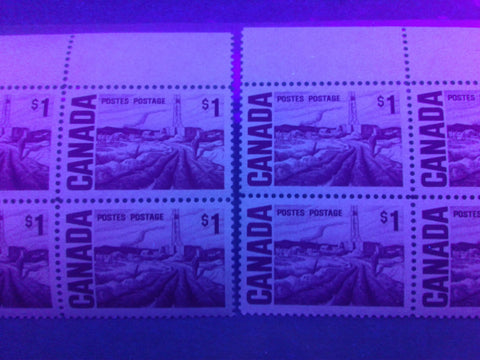 Two varieties of the dull fluorescent paper on the $1 Edmonton Oilfield Stamp of the 1967-1973 Centennial Issue