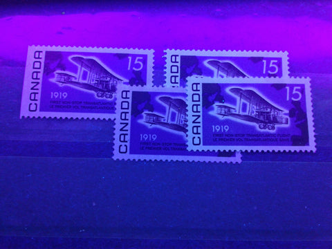 Two varieties of dull fluorescent paper on the 15c Alcock and Brown Stamp of Canada from 1969