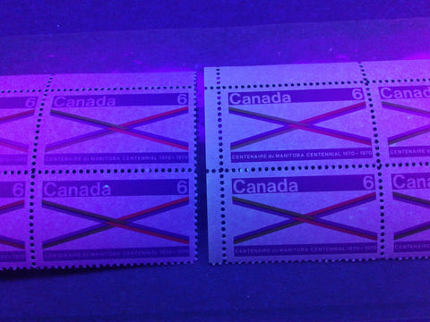Two variations of paper on the 1970 Manitoba centennial issue of Canada