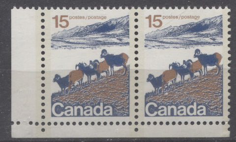 Lower left field stock pair of the 15c Mountain sheep type 2 from the 1972-1978 Caricature issue showing two comb strikes at left