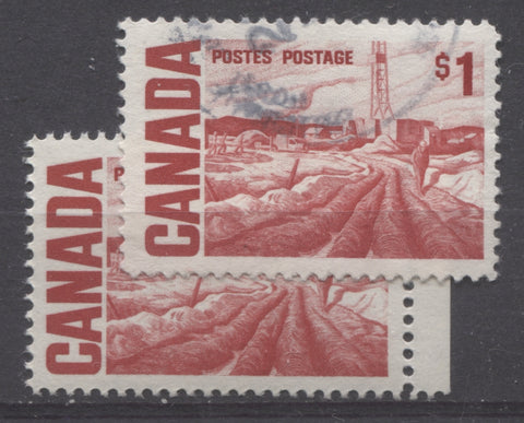 The deep scarlet and bright carmine red shades of the $1 Edmonton Oilfield stamp from the 1967-1973 Centennial Issue of Canada
