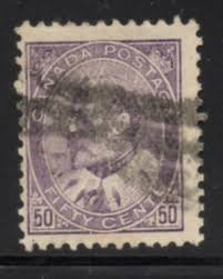Faded example of the 50c Purple King Edward VII stamp of Canada