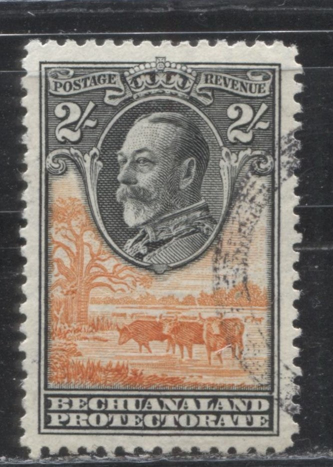 Bechuanaland Protectorate #112 (SG#106) 2/- Black and Orange, King George V and Cattle, 1932 Definitive Issue, A VF Used Example With Somewhat Doubtful Cancel