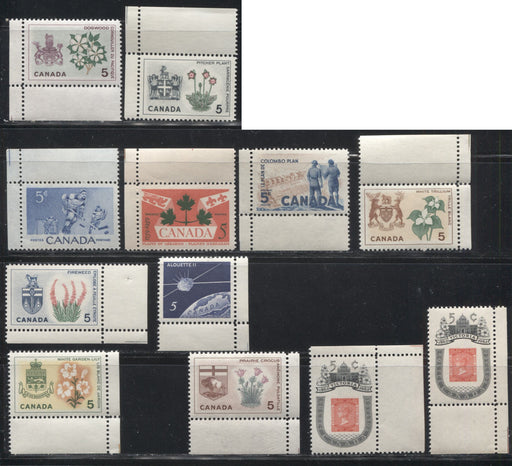 Canada #359/428 1956-1966 Commemoratives, A Group of 12 Different Corner Sheet Singles, Each Showing a Sheet Cutting Guideline, All VFNH
