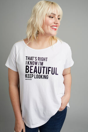 Model wearing Christian Siriano's That's right I know I'm beautiful keep looking plus size t-shirt