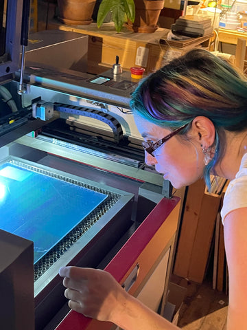 Ashley at the laser cutter