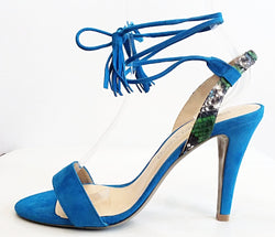 April - Blue Suede Heel by Paco Herrero