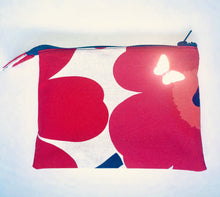 Zero waste bag with top zipper and reflective butterfly detail in red and pink marimekko fabric. Good for carrying make-up.
