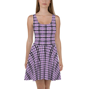 woman wearing casual dress, checkered pattern violet color with black, white and tan stripes, the dress hangs just above the knees