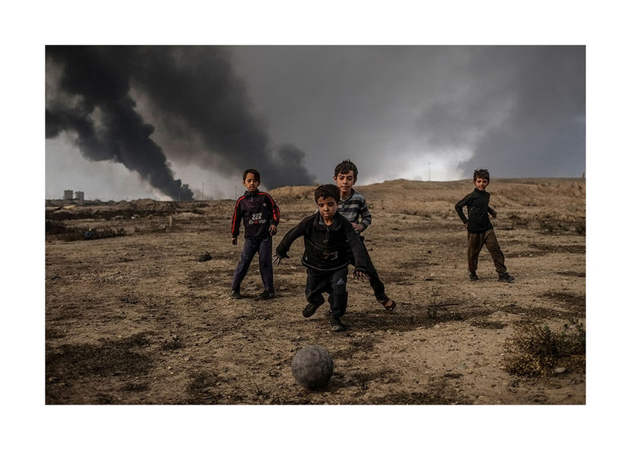 Boys playing football, Mosul 2016 - Photographic color print, stamped and signed by Jan Grarup. Printet on Baryta Fine Art 325 gram paper in A2 (59,4 x 42cm)