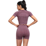 Pink Trendy Seamless Yoga Fitness Set worn by a woman