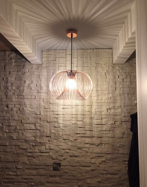 Cream Stone Split Face Tiles Used As A Modern Feature Wall