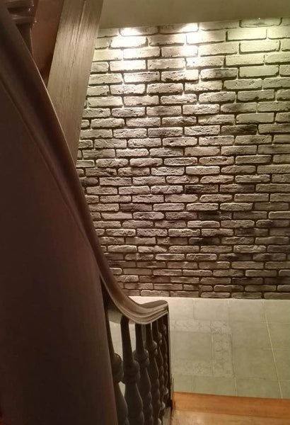 Old Grey Brick Slips Used On A Large Staircase Wall