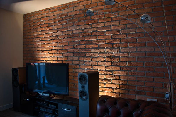 Old Natural Brick Slips Installed As A Feature Wall With Upward Lighting