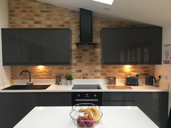 Old Rock Brick Slips Used As A Modern Kitchen Feature Wall