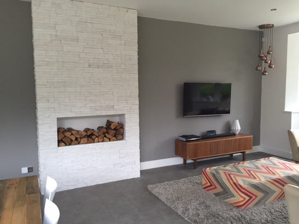 White Stone Split Face Tiles Installed As A Faux Chimney Breast And Fireplace
