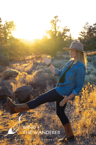 woman in sunset cowgirl boots