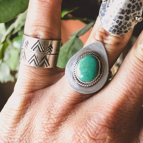 western bohemian turquoise rings on hand