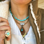 smith rock leather teardrop necklace silver turquoise gold on model