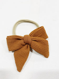 DARLING BOW ON NUDE NYLON