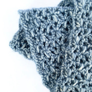 Close-up of Illimani's Amelie Yarn in Denim Blue, crocheted Classic Snood by Erika Knight