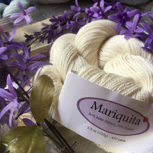 Load image into Gallery viewer, The Alpaca Yarn Company's Mariquita Yarn in First Frost #5100 Skein with flowers