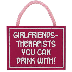 Pink wood friends sign reads - girlfriends, therapists you can drink with