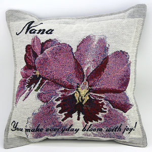 Nana Pillow has purple orchids on a gray background