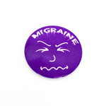 Load image into Gallery viewer, Migraine Face Button Large (2 1/4 inch) - Achy Smile Shop