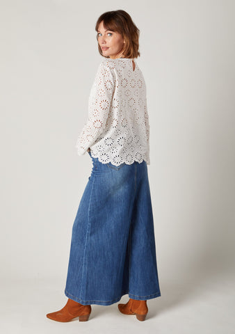 Maxi denim skirt styled with tan suede ankle boots.