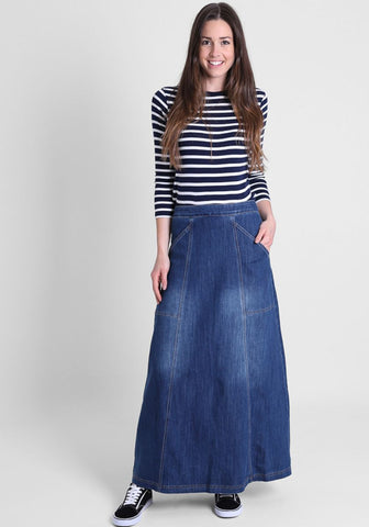 full length denim skirt paired with a black and white hooped sweater.