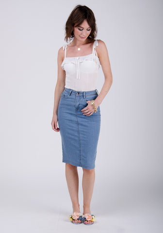 stonewash denim pencil skirt styled with flat sandals