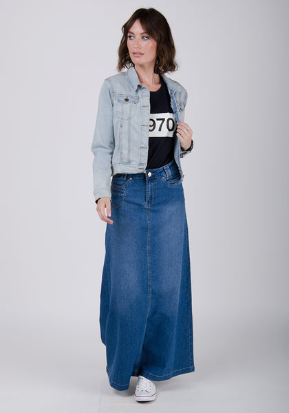 Mid-wash maxi-denim skirt paired with black t-shirt and bleached denim jacket.