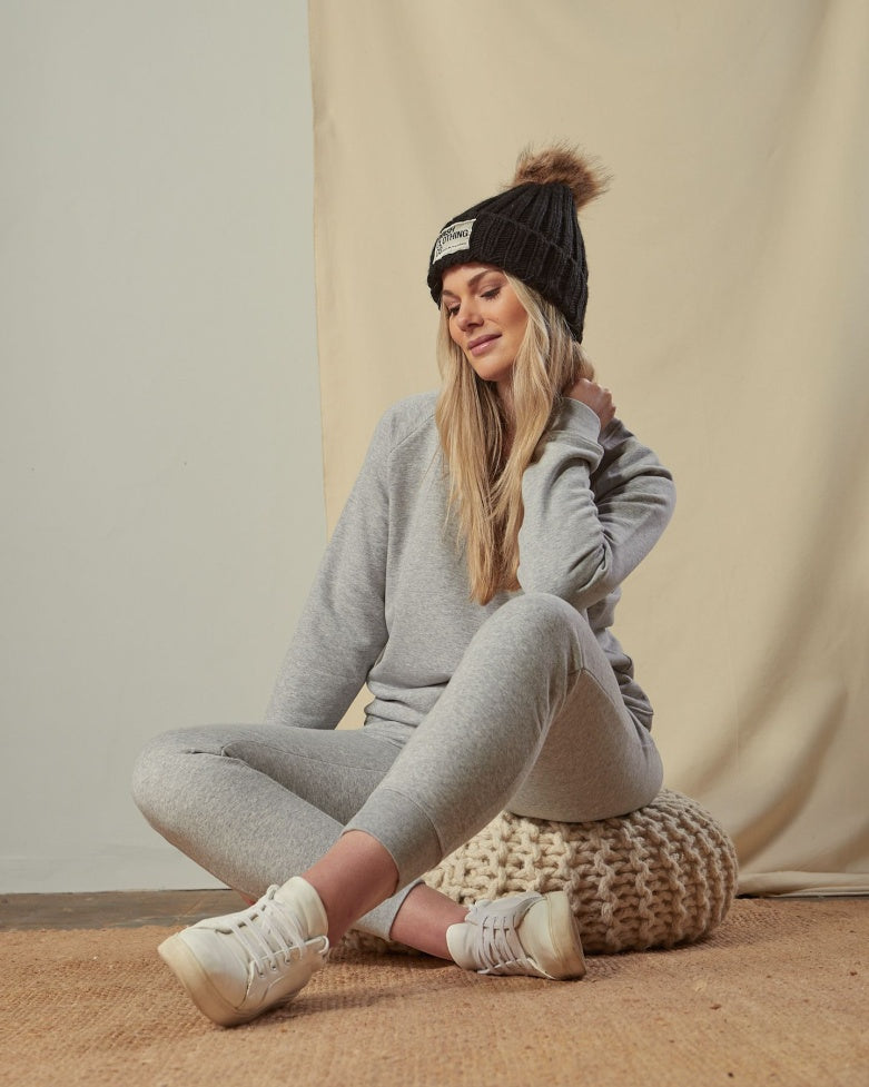 Two-piece, grey loungesuit with black 'WASH' branded bobble hat.