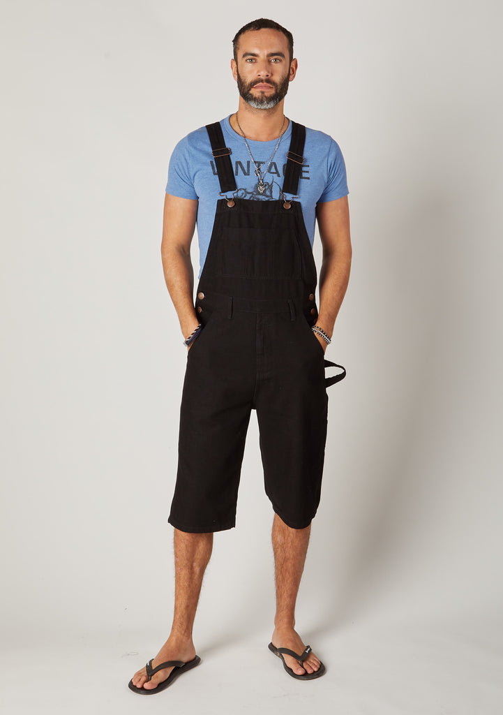 Front full-length pose Chet black denim loose fit dungaree shorts for men