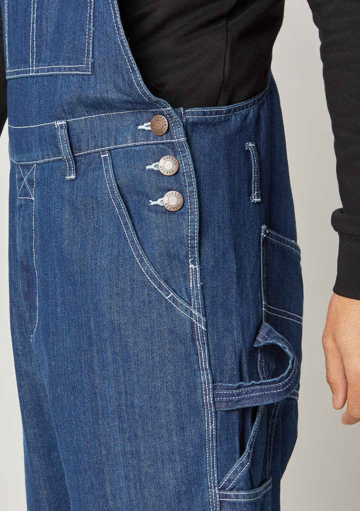 Close-up of Chet Stonewash Denim Dungaree shorts for men showing the side button fastening and belt loops.
