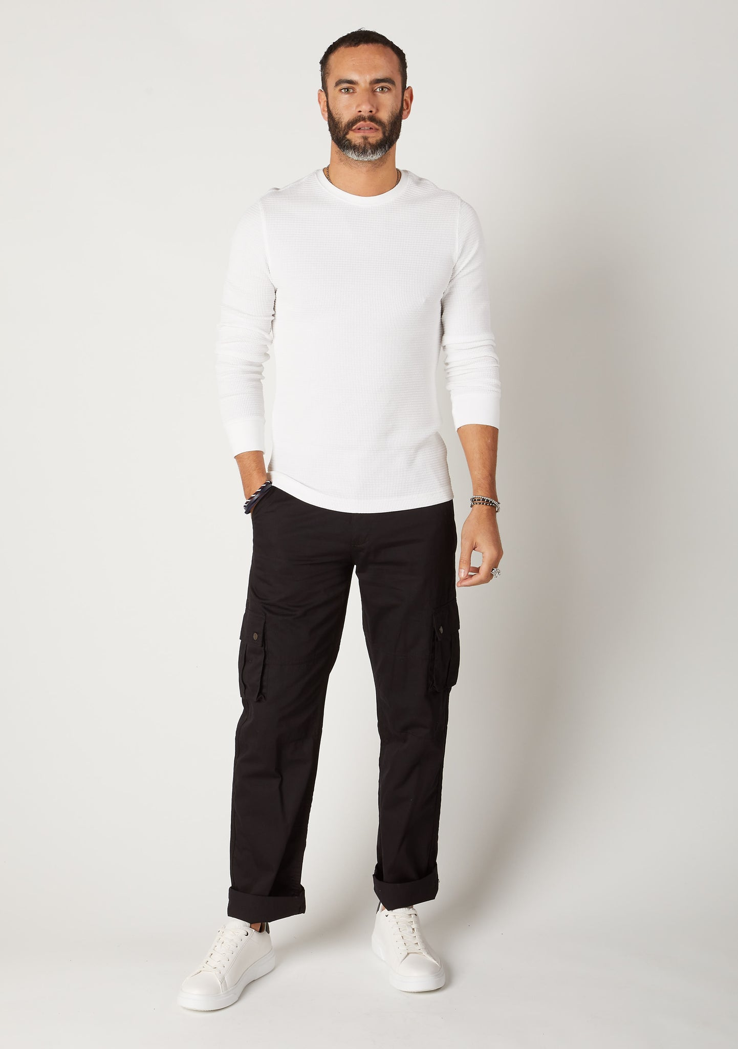 Front full-length shot of loose fit organic cotton cargo trousers in black.