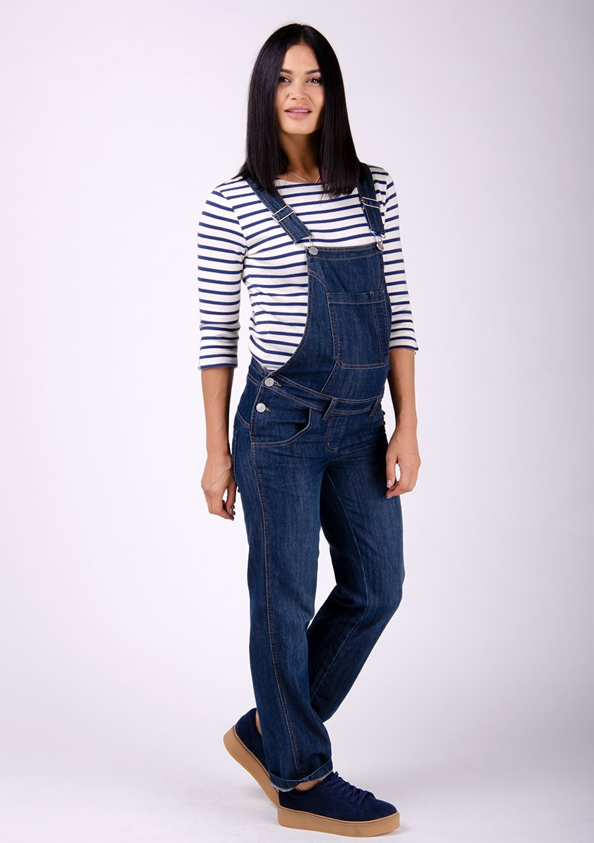 Full frontal pose, wearing Ivy style dark wash blue denim maternity dungarees.